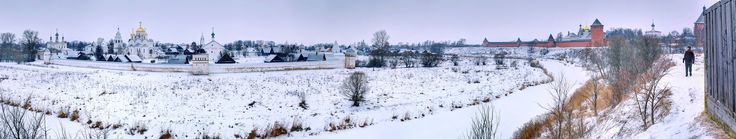 https://flic.kr/p/kzm8mY | 2JO_0322 Panorama | In Suzdal, Russia a local takes his morning walk over looking the frozen Kamenka River with the Ensemble of the Convent of the Intercession (established in1695 and still active) in the distance and the Ensemble the Monastery of Our Savior and St. Euthimis (1531) lying ahead. He was very surprised to find an American on this trail, but quickly became proud and engaging as he recognized the mutual appreciation for the beauty and cultural…
