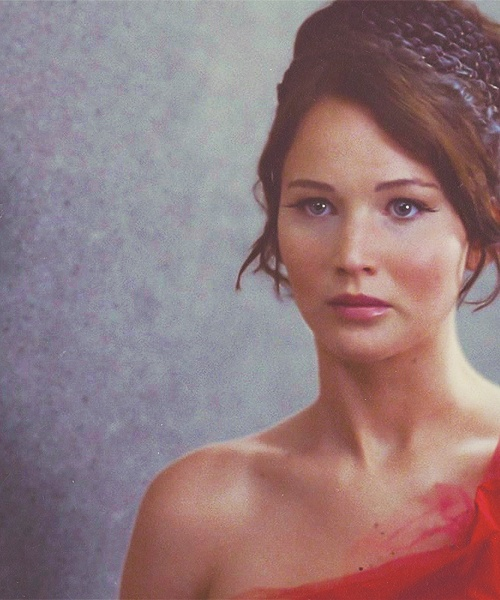 Katniss Everdeen, the girl on fire! .... I need to learn how to do this hair style.