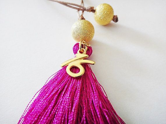 2016 Lucky Charm Beautiful handmade decorative lucky charm. Purple synthetic tassel and silk cord adorned with cast metal gold plated brass beads. This