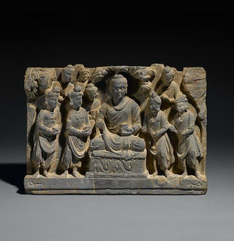 """A schist relief panel of the Offering of Four Bowls to the Buddha Ancient region of Gandhara, 2nd/3rd century 13""""x19"""" USD 22,500"""
