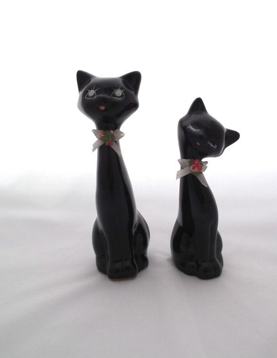 Quirky Vintage pair of Black Cat figurines 1950's http://www.etsy.com/listing/126584936/quirky-vintage-pair-of-black-cat?ref=sr_gallery_13_search_query=cat+figurine_view_type=gallery_ship_to=US_spelling_accepted=cat+figuine_search_type=all