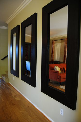 We can't get enough of these Mongstad Mirrors from IKEA.  Pair them together in threes and you make quite a statement (for only $300!)   http://www.simplystunningspaces.net