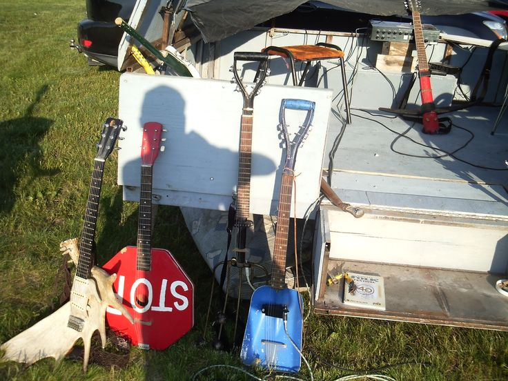 Assortment of guitars, banjos and violins made from everyday tools and sporting equipment