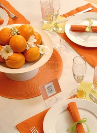 We are doing a version of this with Trifle dishes and grayish silver center placemats. Our Tablecloths will be ivory and our napkins will be orange. No placemats under the plates.
