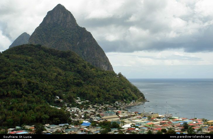 The Pitons in St. Lucia- see it by catamaran. Huge green pyramids rising from the ocean.  amazing