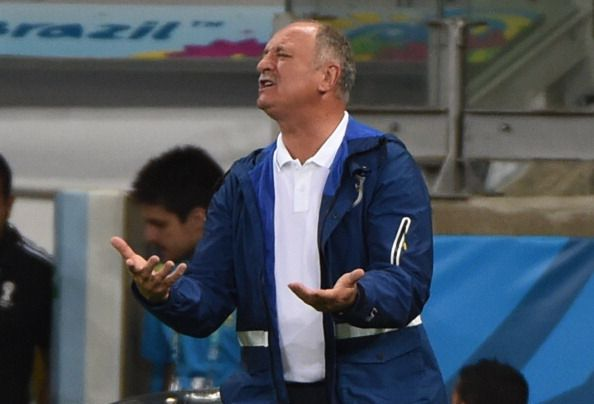 Brazil's coach Luiz Felipe Scolari reacts after goal number seven against his side during the semi-final football match between Brazil and Germany at The Mineirao Stadium in Belo Horizonte on July 8, 2014, during the 2014 FIFA World Cup