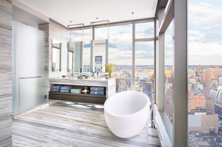 Apartment: Awesome Modern Bathroom Design Ideas With White Oval Freestanding Bathtub Also Wooden Vanity Unit Table And Walls Mixed With Huge Sectional Glass Windows Also Frosted Glass Doors: Awesome Apartment At New York City By Famous Home Designer