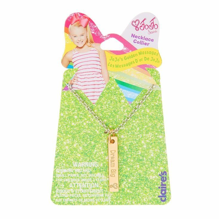 "Dream Big and show the world you are JoJo Siwa's Number One Fan with this adorable gold pendant message necklace from the JoJo Siwa Collection. The gold pendant is engraved with ""Dream Big"" and the signature JoJo Siwa heart. Pendant is attached to a silver chain with a lobster clasp."