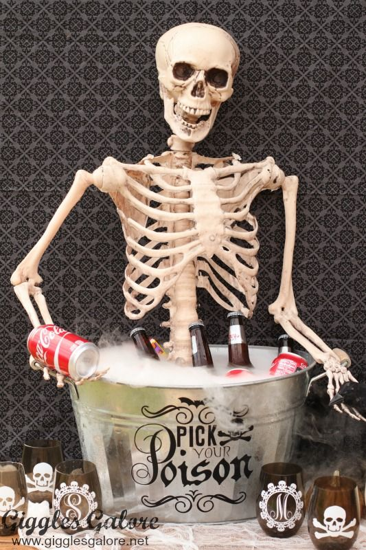 Entertain guest this Halloween with a Pick Your Poison Bar and a creative DIY Skeleton Drink Bucket.  via:  porch.com
