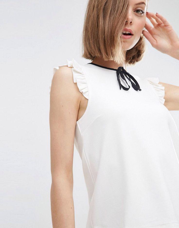 Compra Top sin mangas en tejido de punto roma con lazo en contraste de ASOS  en ASOS. Descubre la moda online.