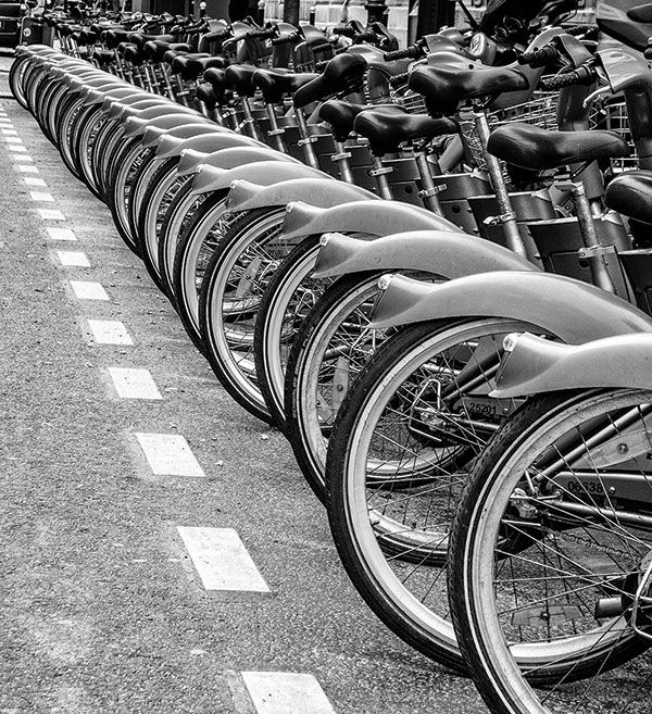 This is an example of maximum depth of field. The image was taken low enough to obtain all the bicycles as well as making sure they are all in focus, creating as if the bicycles never end.