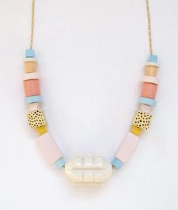"""Bi is one of the large necklazes for Après Ski new collection """"Our Garden Needs Its Flowers"""". This is inspired by Memphis Milano, a movement of architecture and industrial design in the 80s, Art Deco and Africanism are also influences, all mixed with the subtlety of color and geometric shapes typical from Après Ski."""