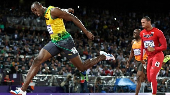 Usain Bolt roared away from the field to defend his gold medal in the 100m with a blazing, Olympic record 9.63 seconds.