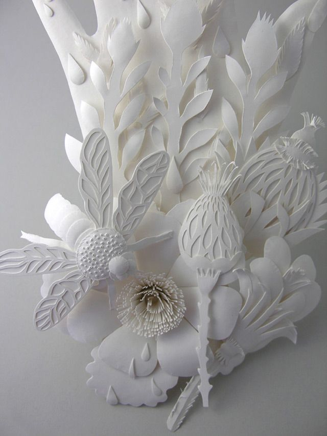 Elsa Mora is a multimedia artist who works with a plethora of materials. Her paper cuts are among her most impressive pieces, but you should also check out the work she does with flowers – folding and arranging them to create charming characters.