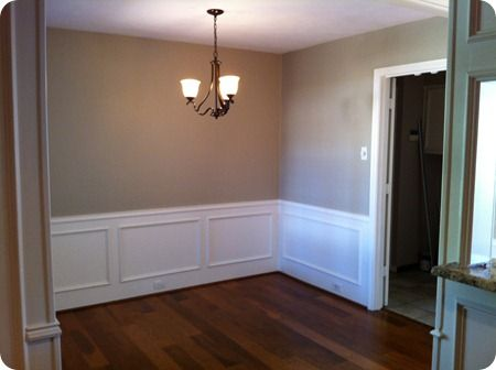 One of my favorite neutrals.  'Creamy Mushroom' by Behr.  Used it in our first house....will be painting our new living room with the same color.