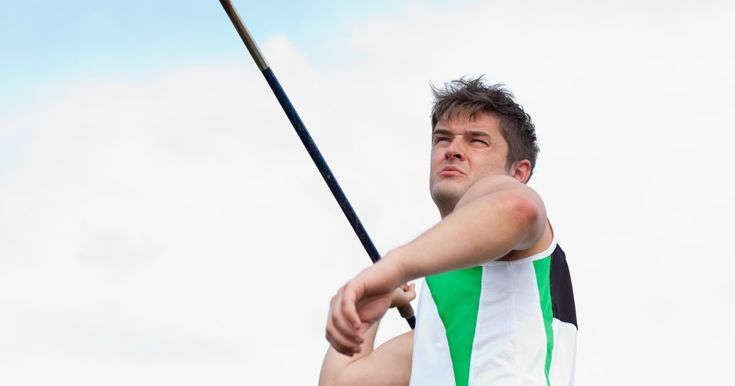 The javelin throw is one of the few throwing field events in athletics competitions. Unlike the shot put or hammer toss, javelin throwing requires as much flexibility and speed as it does brute strength. Your body must operate as single unit to quickly transfer the force of your lead-up run into a long-distance javelin throw.