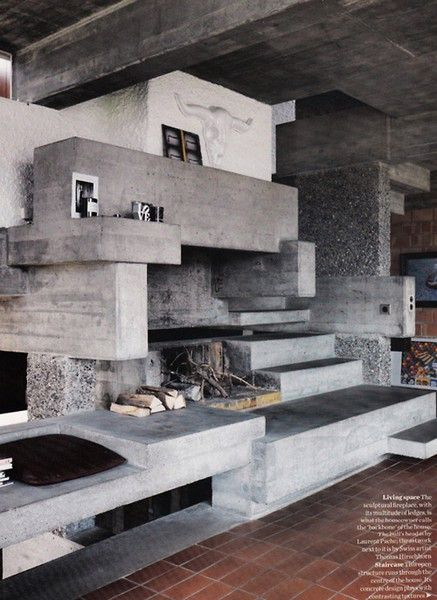 Beautifully complex fireplace in concrete.
