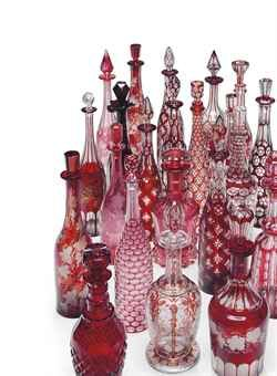 A collection of Twenty-two ruby glass decanters and stoppers...19th-20th century. Beautiful!