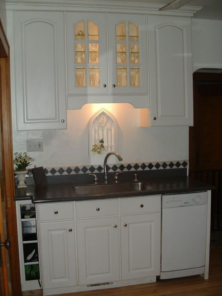 Kitchen Cabinets With Decorative Shelf Above Sink ...