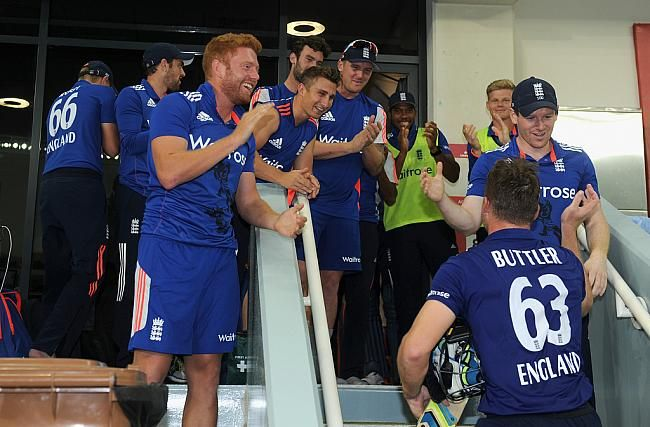 Jos Buttler of England is congratulated as he returns to the dressing room after making 116 not out during the 4th One Day International between Pakistan and England at Dubai Cricket Stadium on November 20, 2015 in Dubai.