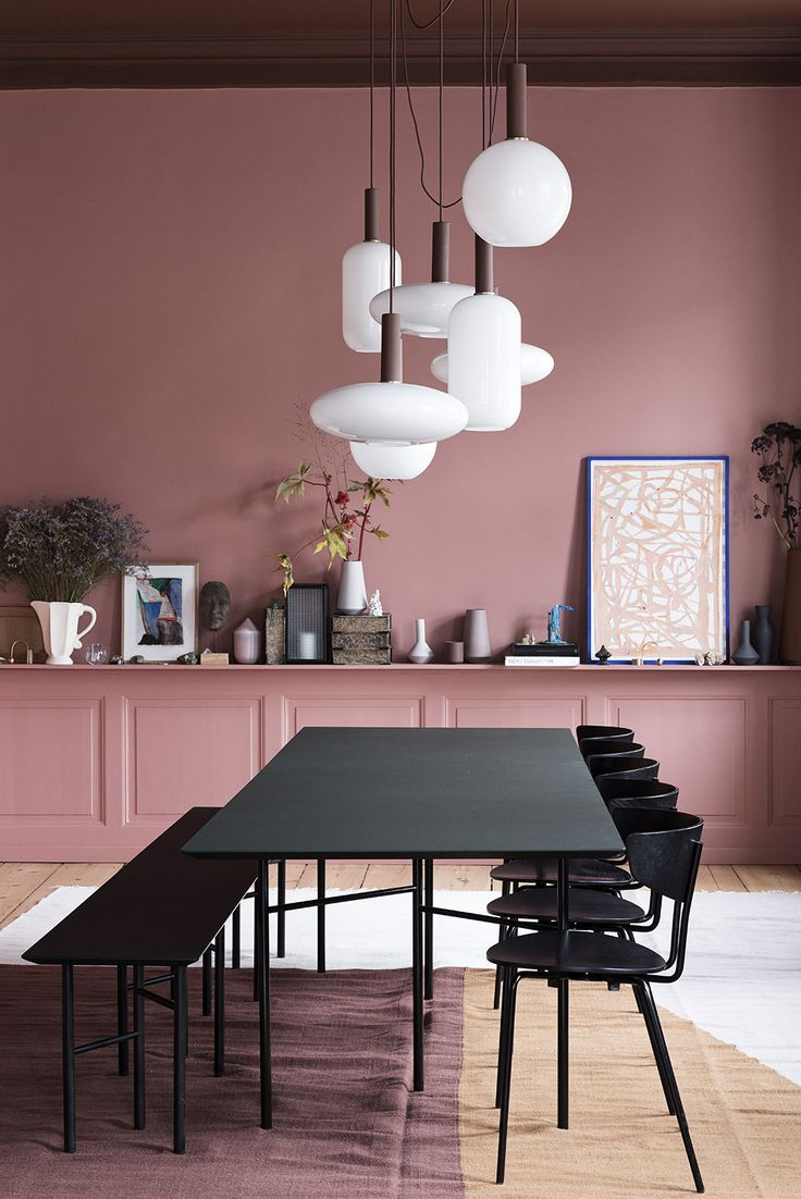 Ferm Living have decorated a classic, old apartment in Amagertorv, Copenhagen. Ferm Living Home interiors home decor pink Peach decor. Black dining table. White drop lighting. Picture accessories Scandi design modern on trend Scandinavian