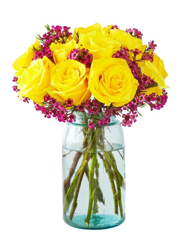 Yellow roses and purple wax flower in a Mason jar. HGTV Celebrity Flower Arrangements : Decorating : Home & Garden Television