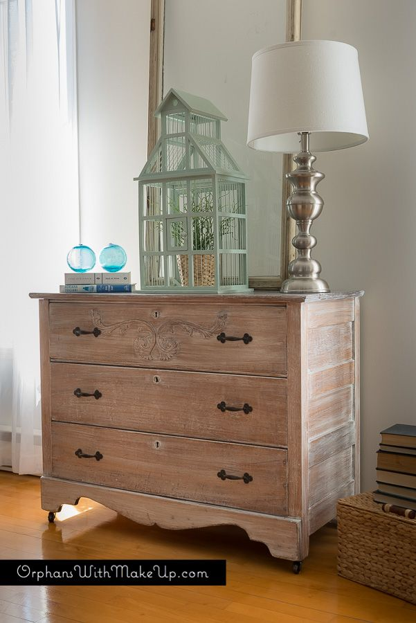 """How To Whitewash Furniture There are different ways to go about whitewashing furniture. I used a combination of watering down my paint quite heavily, wiping, dry brushing and sanding. This technique requires so little paint, so if you are left with just bottoms of paint in your cans, think of using them up this way. I used Country Chic Paint in """"Simplicity"""", a pure white color, and watered it down quite a bit. I did not measure it out but it was a lot more water than paint. So I started by…"""