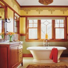 A naturalistic look prevailed in Craftsman-style homes built from 1905 to 1930. Bathrooms often featured clean-lined fixtures and boxy built-ins, as well as block-printed wallpapers and molded tiles with botanical motifs. Photo: Alan Shortall/Cornerhouse Stock | thisoldhouse.com | from How to Create a Modern Bath in a Vintage Style