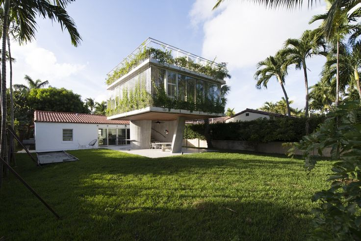 Following a diagram of the sun's path during the summer solstice, this three-story extension is the star of restaurateur and chef Frank Prisinzano's Miami home.