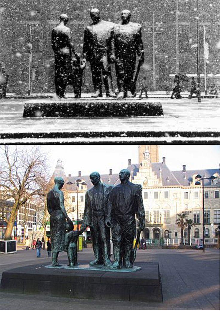 Herrijzen. Lijnbaan, Rotterdam. De vrouw en het kind staan enigszins naar het stadhuis gericht (het verleden). Het kind symboliseert van de schakel tussen verleden en toekomst. De middelste man is de centrale figuur en kijkt naar de vrouw met de herinnering aan haar leed. Hij heeft zijn linkerarm ter ondersteuning om de schouders van de tweede man gelegd, die een schop bij zich draagt (de wederopbouw).