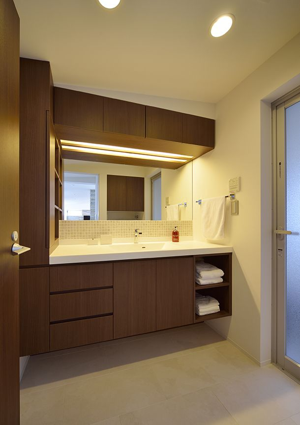 Floating vanity with towel shelves built in