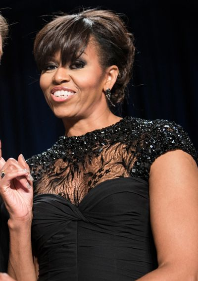 2013 - Michelle Obama chose a fitted Monique Lhuillier Chantilly lace and chiffon gown for the White House Correspondents' Association Dinner in Washington, D.C.
