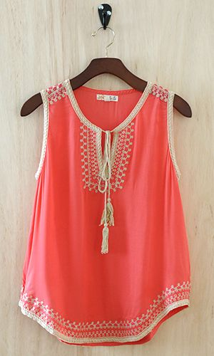 Coral sleeveless blouse with embroidered trim
