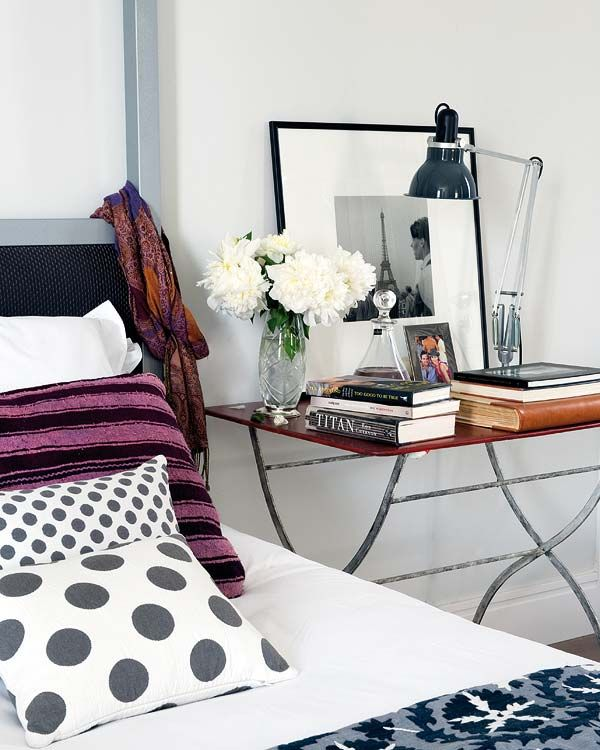 mix of prints bedding . clean bedside table