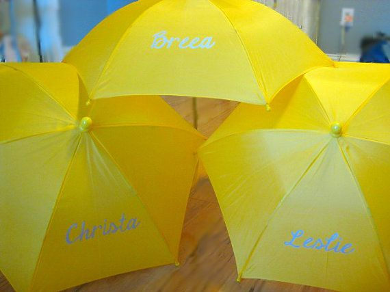 Bridal Party Hand Painted Rain Umbrella Pack Yellow by grisgrisart  Bridal Party Hand Painted Rain Umbrella Pack- Yellow Grey Silver -Personalized Name Monogram Initial Baby Wedding Shower- Choice of Colors These umbrellas were yellow with a silver paint for the name. Give your bridal party a sweet gift  wedding day showers. You can choose the name, initials, saying you would like on the umbrella. Many color combinations are available.