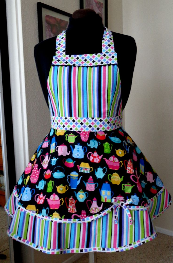 One of a kind apron, Our aprons are all handmade using only the highest quality cotton and cotton blend fabric with coordinating designs and colors while showing a great deal of attention to trims and embellishments. Some have Swarovski crystals, depending on the design.  Custom aprons are available upon request in your favorite theme or colors, as long as it is available in fabric.   You can find me on Facebook, Brendables Designs or Brendables Aprons.