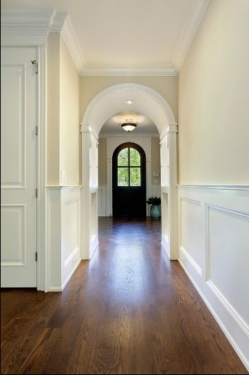 A strong color leads the eye through a space. natural cream OC-14 in a hallway by Mandy Brown. Image from Houzz