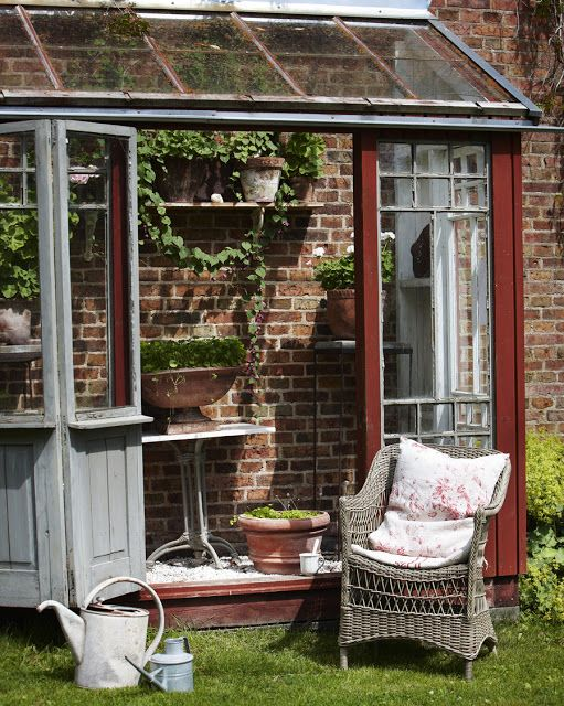 A small porch-nook/greenhouse made from old windows.