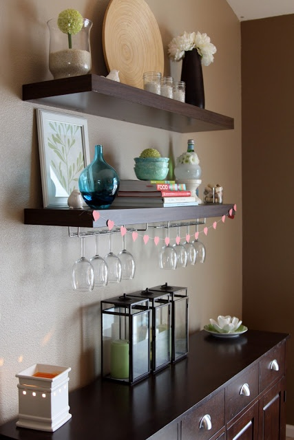 Hang dark wooden shelf above bar w wheels in dining room for What to hang on dining room walls