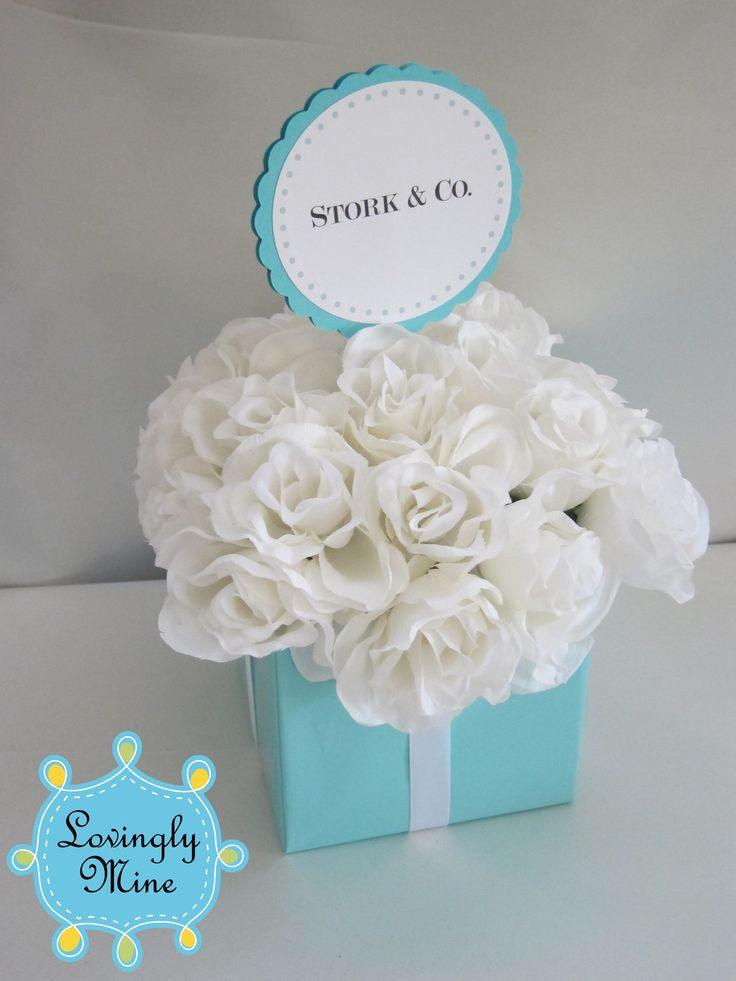 Tiffany blue square vase, white flowers with a touch of pink. (this is a silk centerpiece, we'd do it all in fresh)