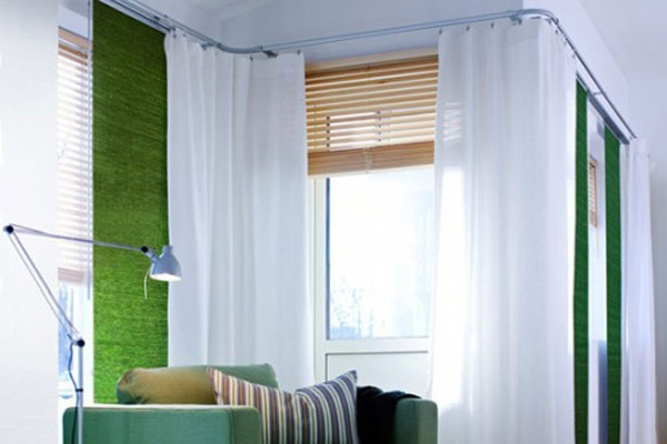 Ikea curtain track. I also like the window coverings...