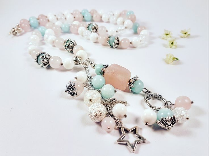 'Star' Handmade and one of a kind necklace 'Star' Made out of Jade, Pearl Oyster, Pink Quartz, Pebble beads and metal inserts Length - 54 cm Necklace comes in original 'Buddha Touch' box