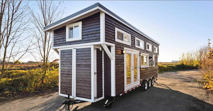 Tiny Living Ltd. delivers a gorgeous tiny house on wheels with the dreamiest interior. - small enough to be moved without a permit!  If the bathroom and kitchen were scaled back this could easily be a one floor layout with optional loft