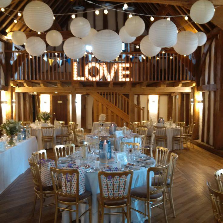 Lovely white and ivory lanterns with a warm white festoon canopy at the beautiful Tudor Barn #barnwedding #weddinglighting #festoon #hanginglanterns #lanternlove #buckinghamshire