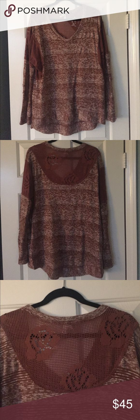 Free People slouchy top Free People long sleeve top with fishnet/crochet design on back neckline, shoulders, and upper sleeves. Loose, casual fit. Comes from a clean, smoke-free home. Free People Tops Blouses