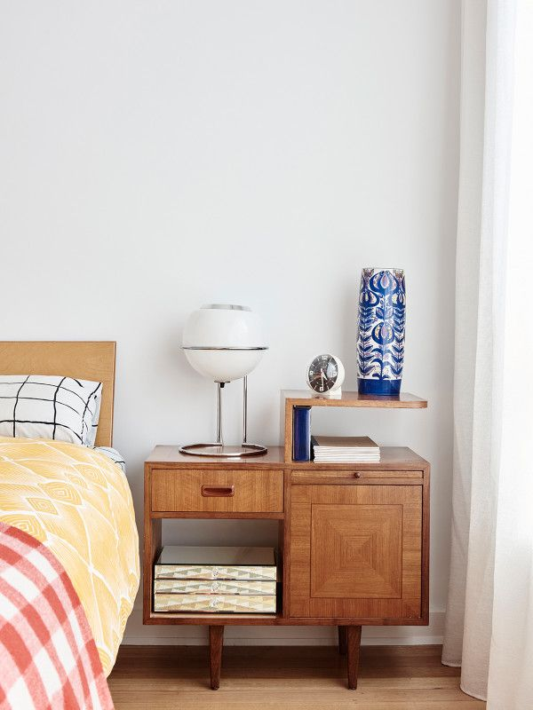 Master bedroom. Royal Copenhagen vase from eBay, vintage dome alarm clock, Case Study bed from Bill Luke, bedside table from Leonard Joel Auctions, and mirror jewellery box. Photo – Eve Wilson. Production – Lucy Feagins / The Design Files.