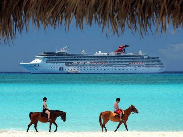 Horseback beach riding at Half Moon Cay, Bahamas.  Email:info@cloud9getaways.com for Carnival Cruise booking info!  #Cloud9Getaways
