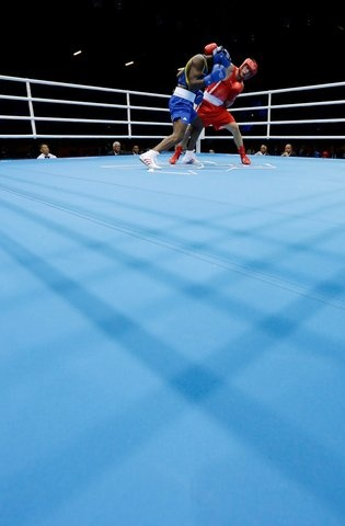 Serbia's Aleksandar Drenovak fights Ecuador's Mario Delgado Suarez, left, during a middle weight 75-kg preliminary boxing match at the 2012 Summer Olympics, Sunday, July 29, 2012, in London. (AP Photo/Patrick Semansky)