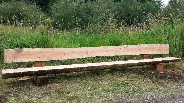 Fourteen feet ten inches of awesomeness on vashon island wa.  Live edge park bench Designed by John Mabry.