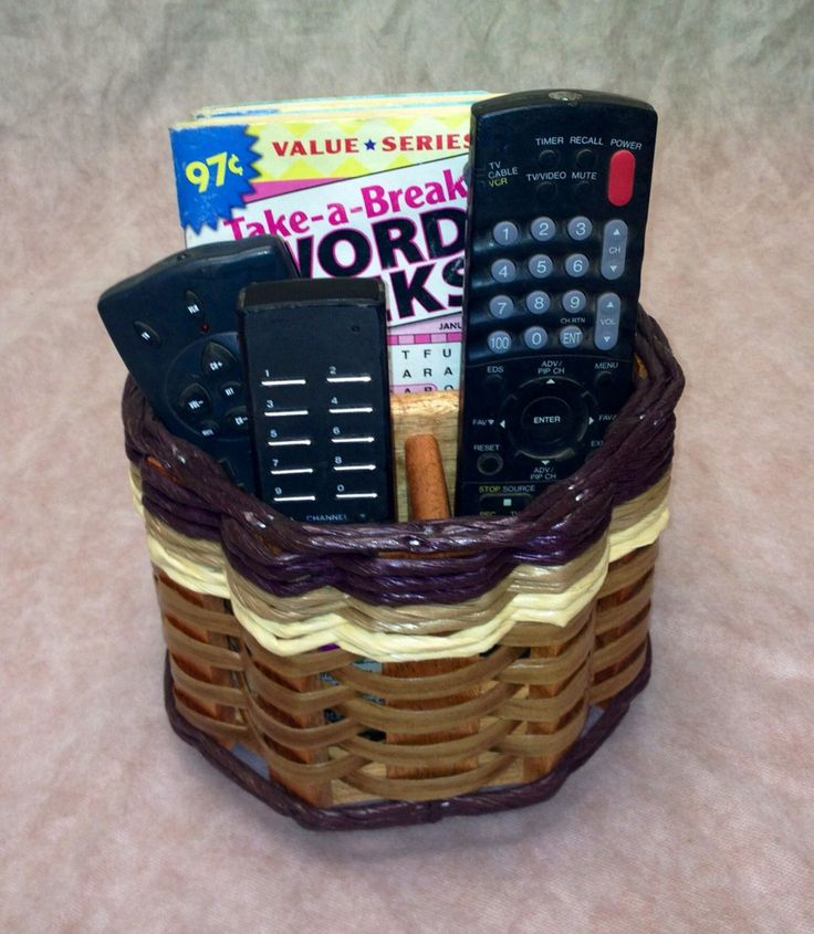 Lazy Susan Remote Basket--Yes it spins! It will hold 4 to 7 remotes and still have room for other items. Its cute octagon shape puts a spin on things and helps keep you organized.
